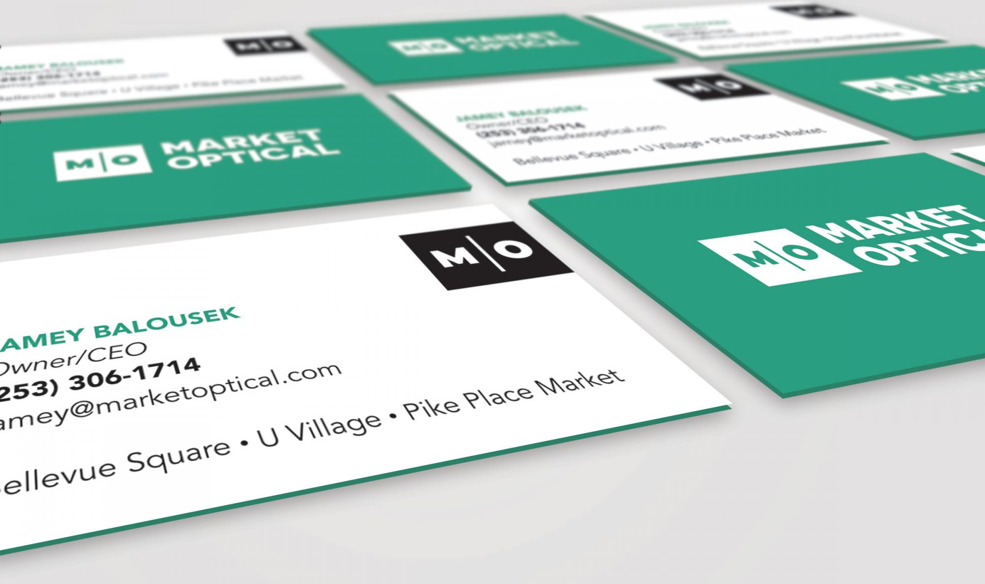 Perspective view of Market Optical business cards front and back